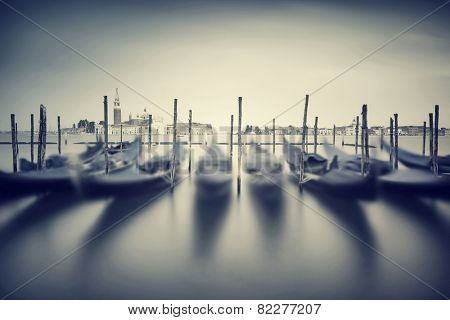 Vintage Venice cityscape , slow motion of beautiful traditional Venetian gondolas, grunge style photo, fine art photography