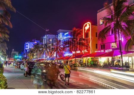 People Visit Ocean Drive Buildings In South Beach At Ocean Drive By Night