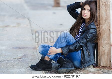 Beautiful fashionable woman in the street of the city.