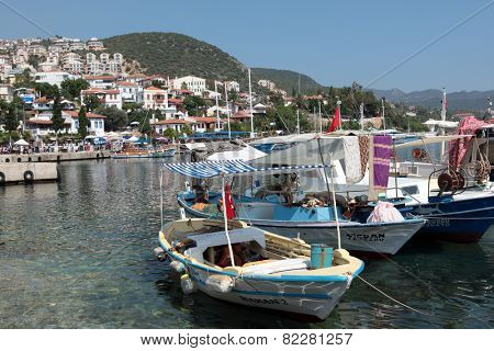 KALKAN, TURKEY - JUNE 27, 2012: Fishermens boat in the bay. During the 19th century, Kalkan was an important port, even more so than Fethiye or Antalya