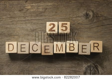 25 of December text on a wooden background