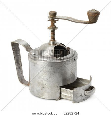 old manual coffee grinder isolated on white