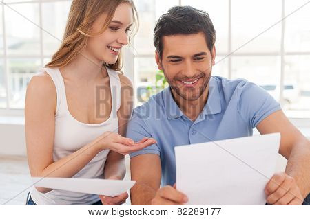 Couple Examining Documents.