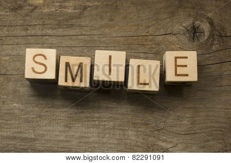 smile word on toy bricks on the table