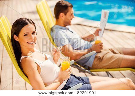 Enjoying Orange Fresh Poolside.