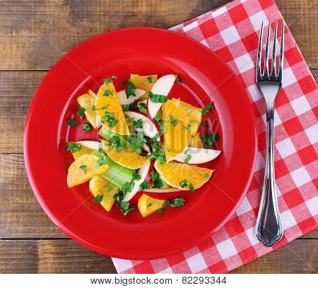 Waldorf salad with orange on plate on table close up