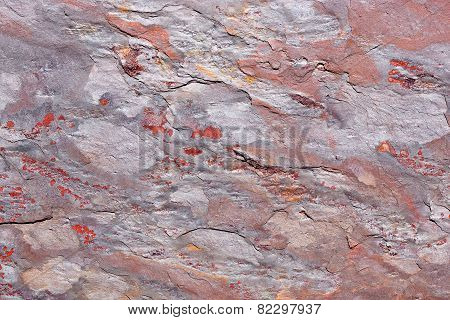 Stone slab with a pattern in gray, purple, red