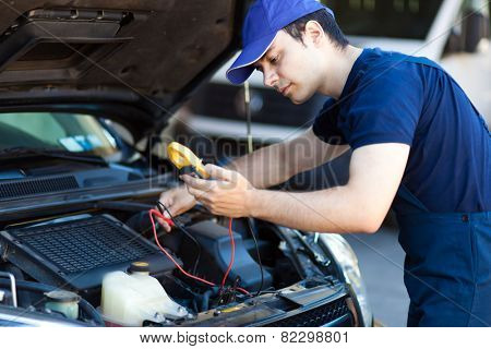 Mechanic working on a car engine