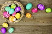 pic of wood craft  - Easter egg border with nest over an old wood background - JPG
