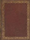 picture of leather tool  - Old brown leather book cover with gold floral tooling border pattern - JPG