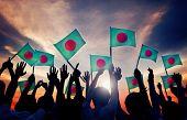 stock photo of bangladesh  - Silhouettes of People Holding Flag of Bangladesh - JPG