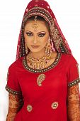 stock photo of rajasthani  - Beautiful Asian bride smiling against white background - JPG