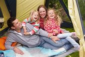 pic of camper  - Family Enjoying Camping Holiday On Campsite  - JPG