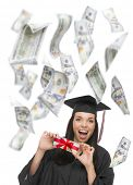 foto of white gown  - Excited Female Graduate in Cap and Gown Holding Stack of  - JPG