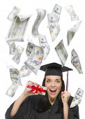 pic of white gown  - Excited Female Graduate in Cap and Gown Holding Stack of  - JPG