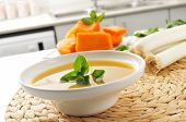picture of leek  - a bowl with vegetable soup and some of the ingredient to prepare it - JPG