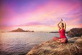 foto of karnataka  - Woman doing meditation in red costume on the stone near the ocean in Gokarna Karnataka India - JPG