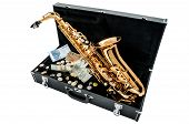 picture of wind instrument  - Saxophone instrument over case with money isolated on white - JPG