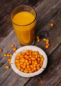 picture of sea-buckthorn  - Sea buckthorn on the wooden table - JPG