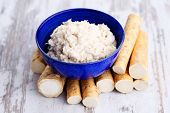 stock photo of grated radish  - horseradish root and grated horseradish - JPG