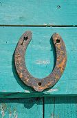foto of horseshoe  - old rusty horseshoe luck symbol on farm barn wooden wall - JPG