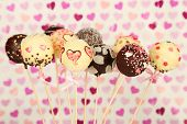 stock photo of cake pop  - Tasty cake pops on color background - JPG