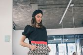 stock photo of turban  - Beautiful young brunette with turban posing in an office - JPG