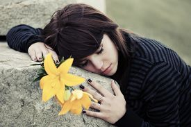 picture of tombstone  - Sad young woman lying on the tombstone  - JPG