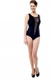 picture of monokini  - Full length of smiling woman posing in swimsuit - JPG