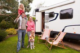 foto of camper  - Family Enjoying Camping Holiday In Camper Van  - JPG