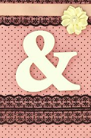stock photo of ampersand  - Wooden ampersand symbol on polka dots background - JPG