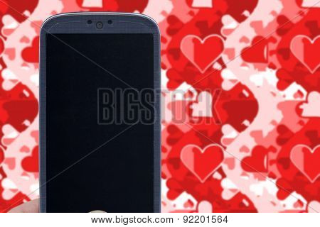 Blue smartphone and love wallpaper. Idea for Valentines Day messages, love, lovers, love apps, Internet, blogs and others.