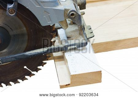 Circular Saw Cutting Wood Isolated On White
