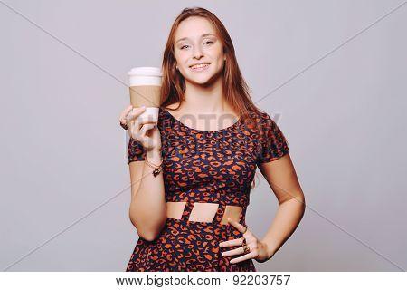 Young Beautiful Woman Drinking Coffee.