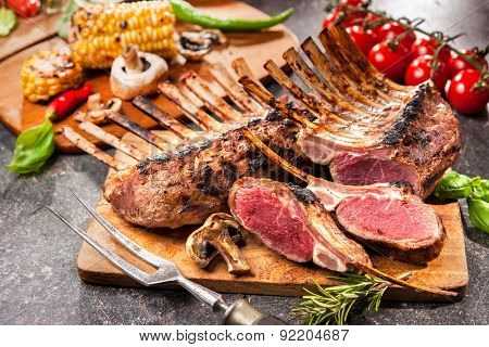 Grilled Rack of lamb on a cutting board