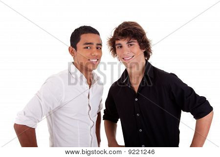 Friends: Two Young Man Of Different Colors,looking To Camera And Smiling, Isolated On White, Studio