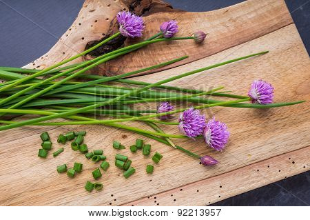 Bunch Of Fresh Chives On A Wooden Table