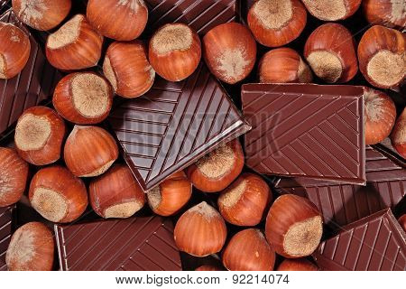 Chocolate And Hazelnuts As Background