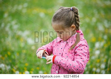 Girl Checking Photos She Made With Smart Phone