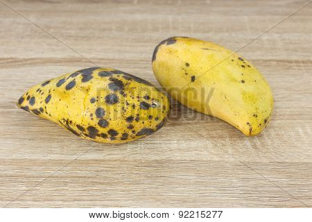 Rotten Mango On Wood Background