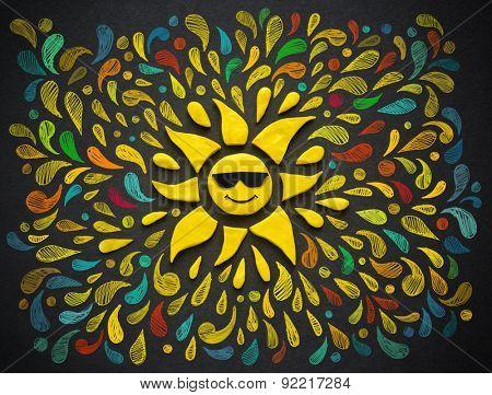 Decorative sun on black background. Plasticine illustration.