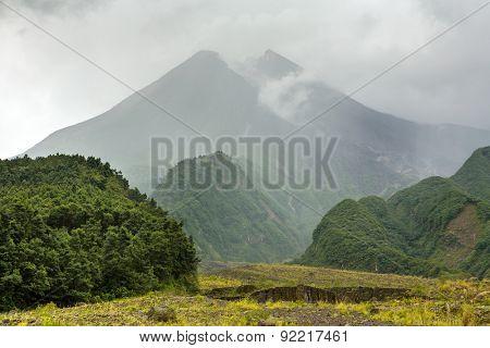 Mountain Merapi volcano at rainy day, Java, Indonesia