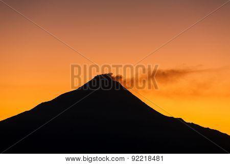 Merapi volcano on sunrise viewing from Borobudur Temple (silhouette scene)