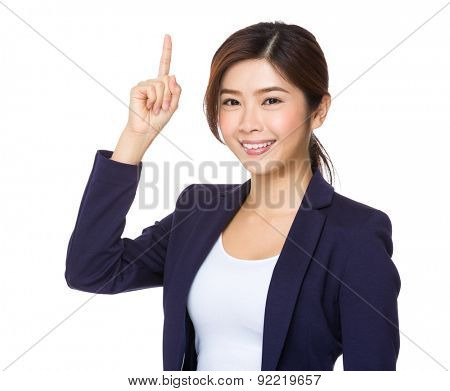 Asian businesswoman with finger pointing upwards