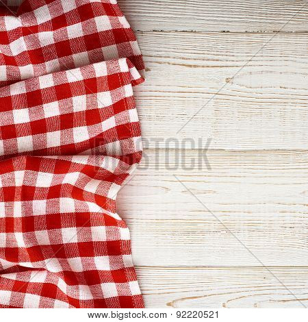 Tablecloth tartan on white wooden table. Flat mock up. Top view.