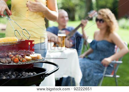 People Enjoying On Garden Party