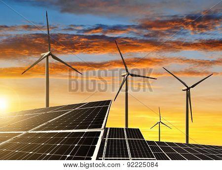 Solar panels with wind turbines