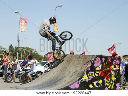 Bmx Cyclist Performs A Stunt On The Ramp