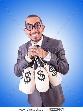 Man with sacks of money on white