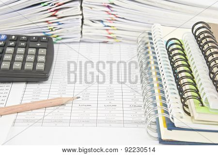 Pencil And Notebook With Calculator On Finance Account
